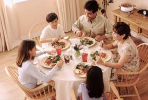 family eating dinner around table