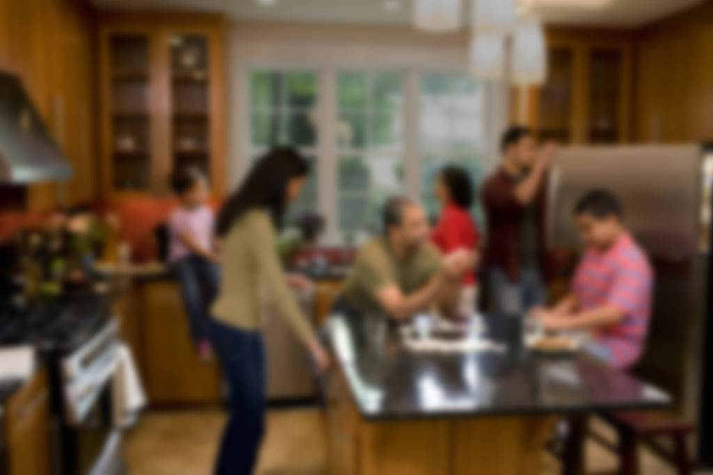 family talking in kitchen