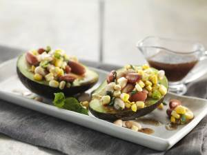 Avocado Corn Bean Salad served in Avocado on plates