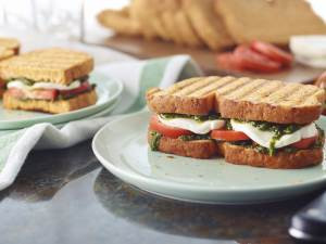 Caprese Panini cut in half on a plate