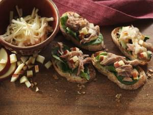 4 Cherry Balsamic Pork Crostinis on a cutting board