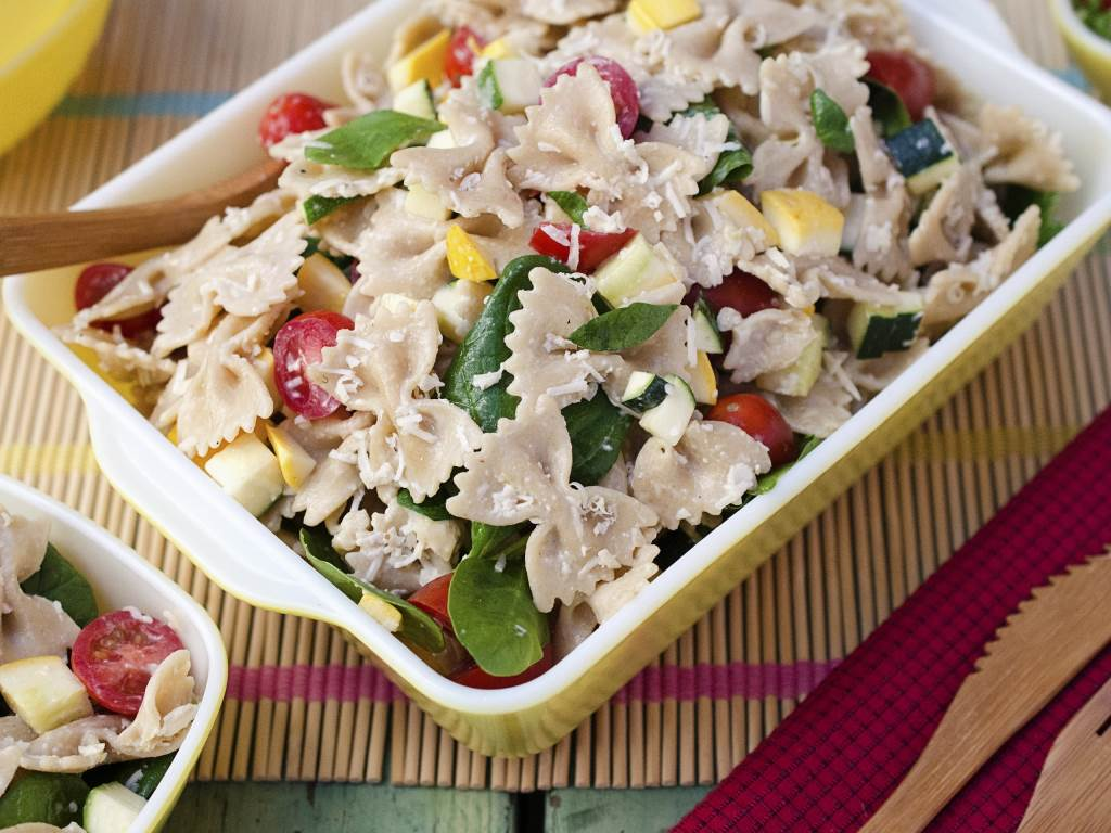 Summer Vegetable Ceasar Pasta Salad in a rectangular serving bowl